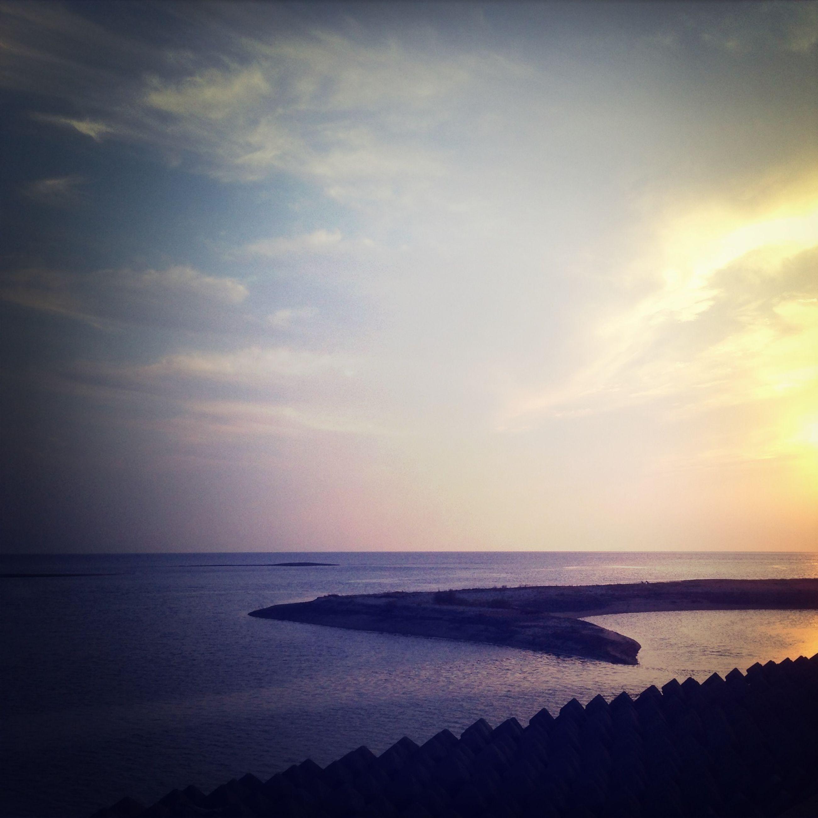 sea, horizon over water, water, sunset, scenics, tranquil scene, sky, beauty in nature, tranquility, beach, nature, shore, idyllic, orange color, cloud - sky, outdoors, no people, cloud, coastline, nautical vessel
