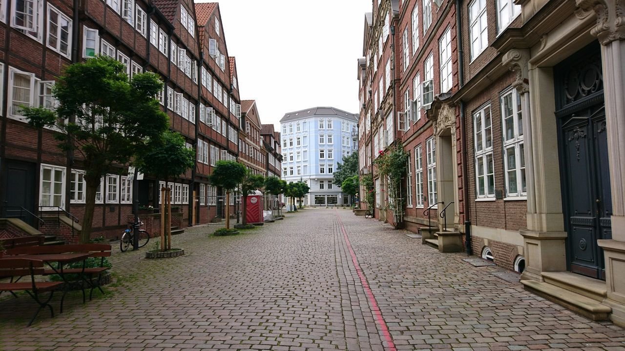 architecture, building exterior, built structure, the way forward, cobblestone, street, day, outdoors, no people, tree, city, clear sky, sky