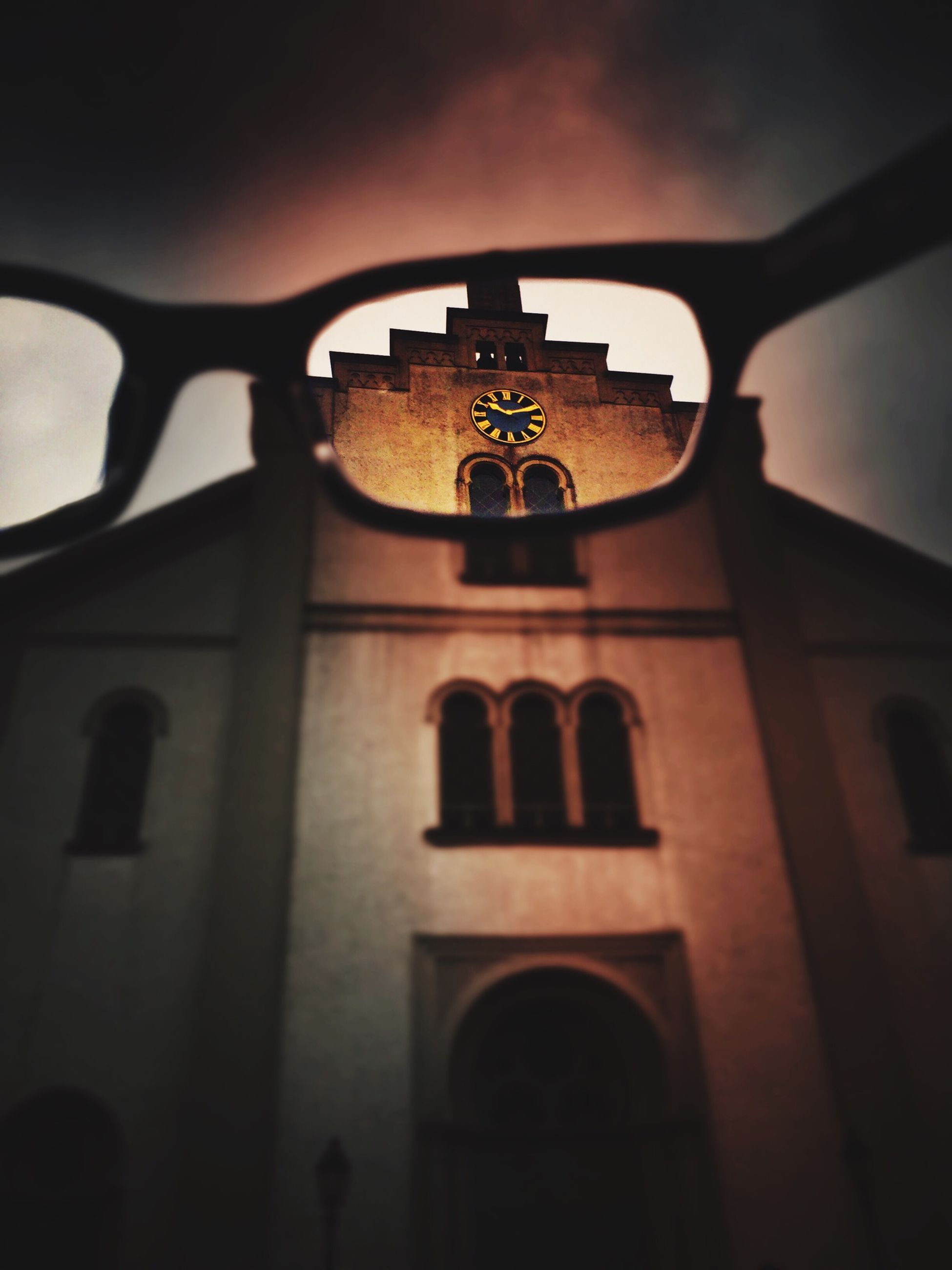 low angle view, building exterior, architecture, built structure, church, religion, sky, window, lighting equipment, clock, no people, close-up, time, outdoors, communication, old-fashioned, day, focus on foreground