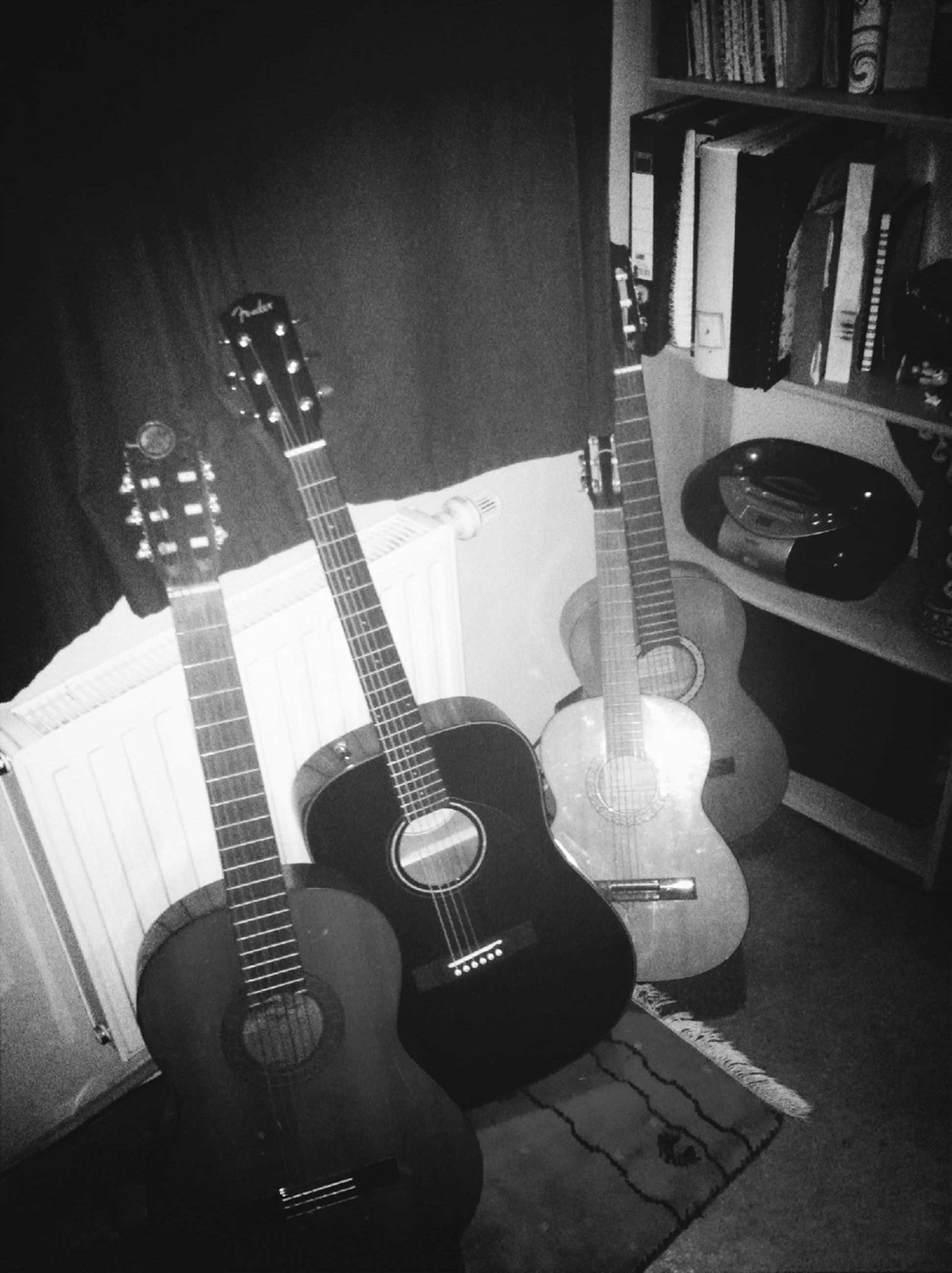 indoors, music, musical instrument, arts culture and entertainment, guitar, musical equipment, table, chair, still life, musical instrument string, home interior, technology, high angle view, wireless technology, string instrument, hobbies, absence, close-up, shadow, acoustic guitar