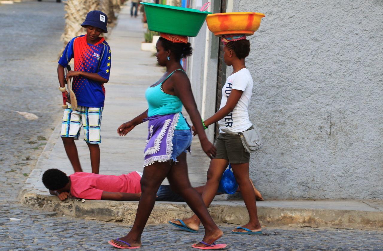 Boys Capo Verde Day Enjoyment Full Length Lifestyles Lying On The Floor Outdoors Pail On Head Real People Sal Island Santa Maria Summer 2015 The Street Photographer - 2017 EyeEm Awards Walking Women