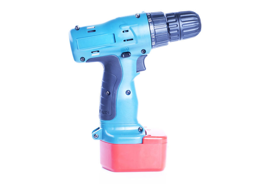 cordless drill over white background Battery Cordless Drill Hardware Hole Lithium Machine Over White Background Power Tools Screw Tools