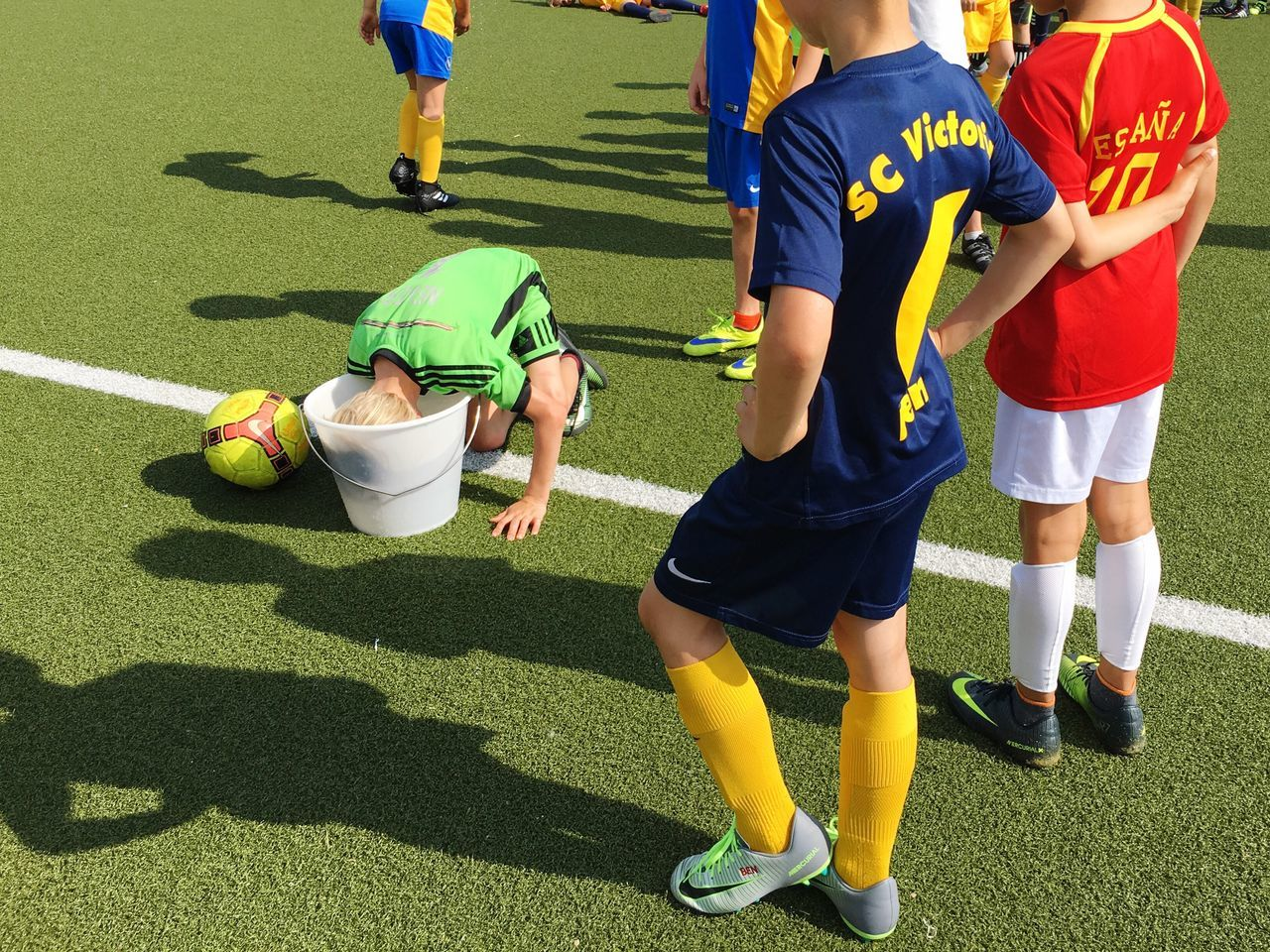 Refreshment... Soccer Boys Soccer Player Three People Soccer Field Sports Uniform Sport Day Soccer Uniform Green Color Grass Teamwork Childhood Outdoors Match - Sport People Strategy Standing Low Section