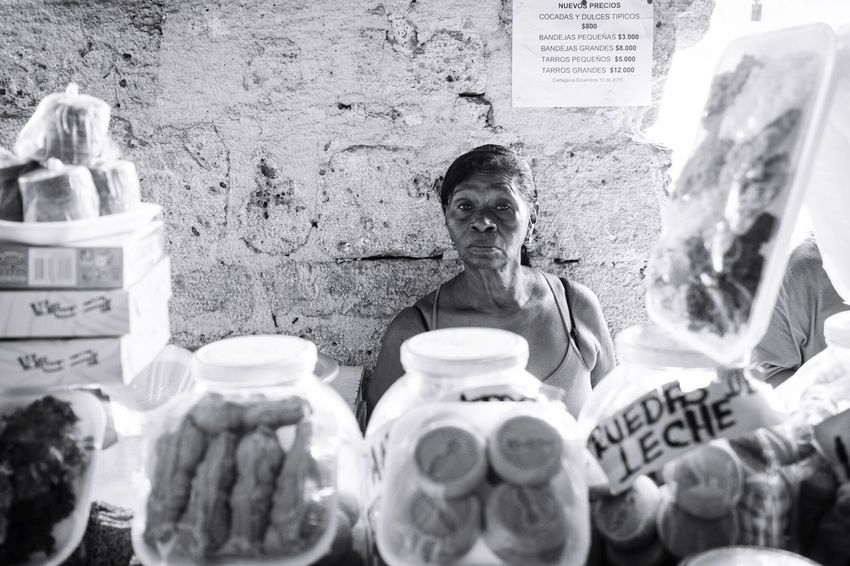 behind the sweets Cartagena, Colombia Street Portrait B&W Portrait Shopping