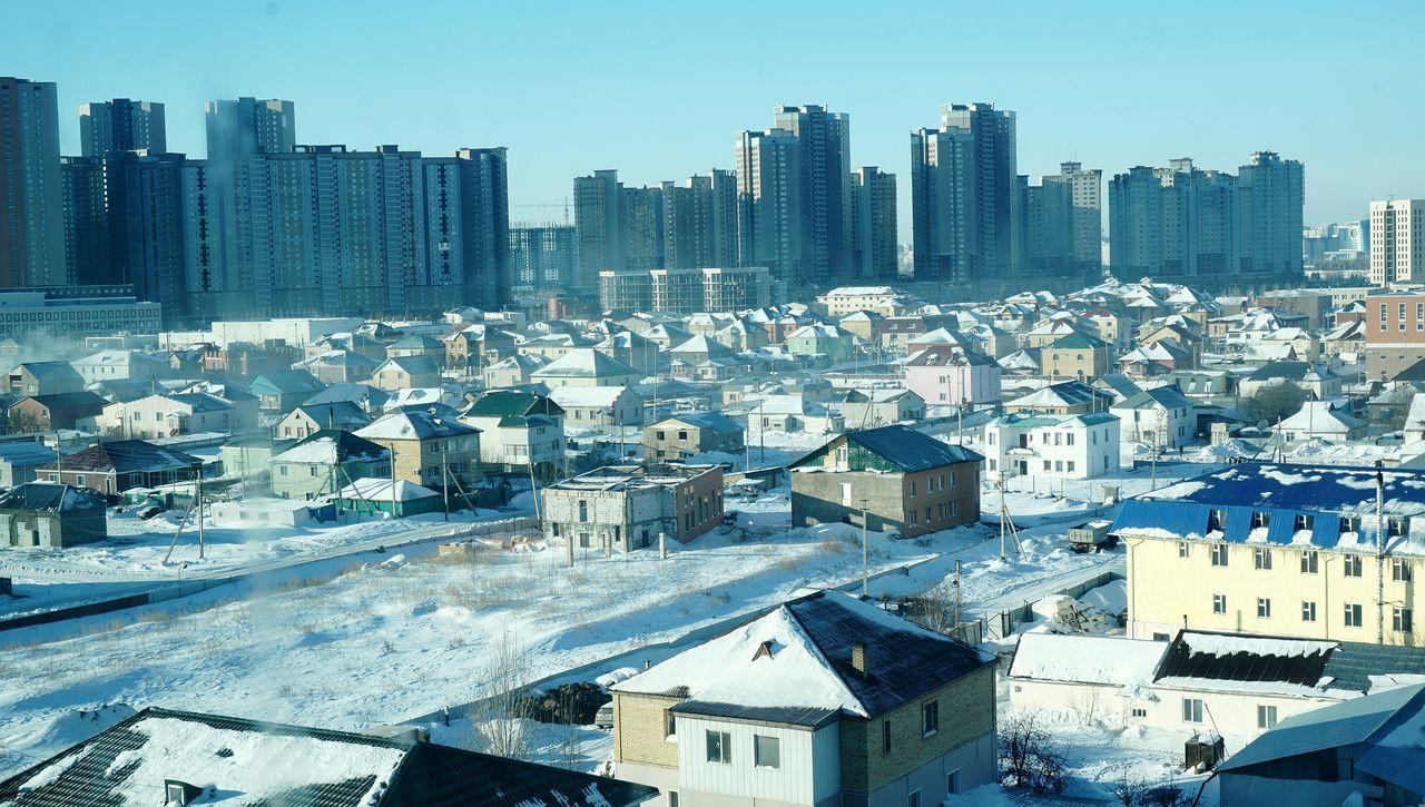 카자흐스탄 City Expo Kazakhstan Astana Cityscape Architecture Apartment Urban Skyline Building Exterior Skyscraper Travel Destinations Residential Building Crowded Sky Built Structure City Life Tower Outdoors Roof Cold Temperature Snow Landscape Day