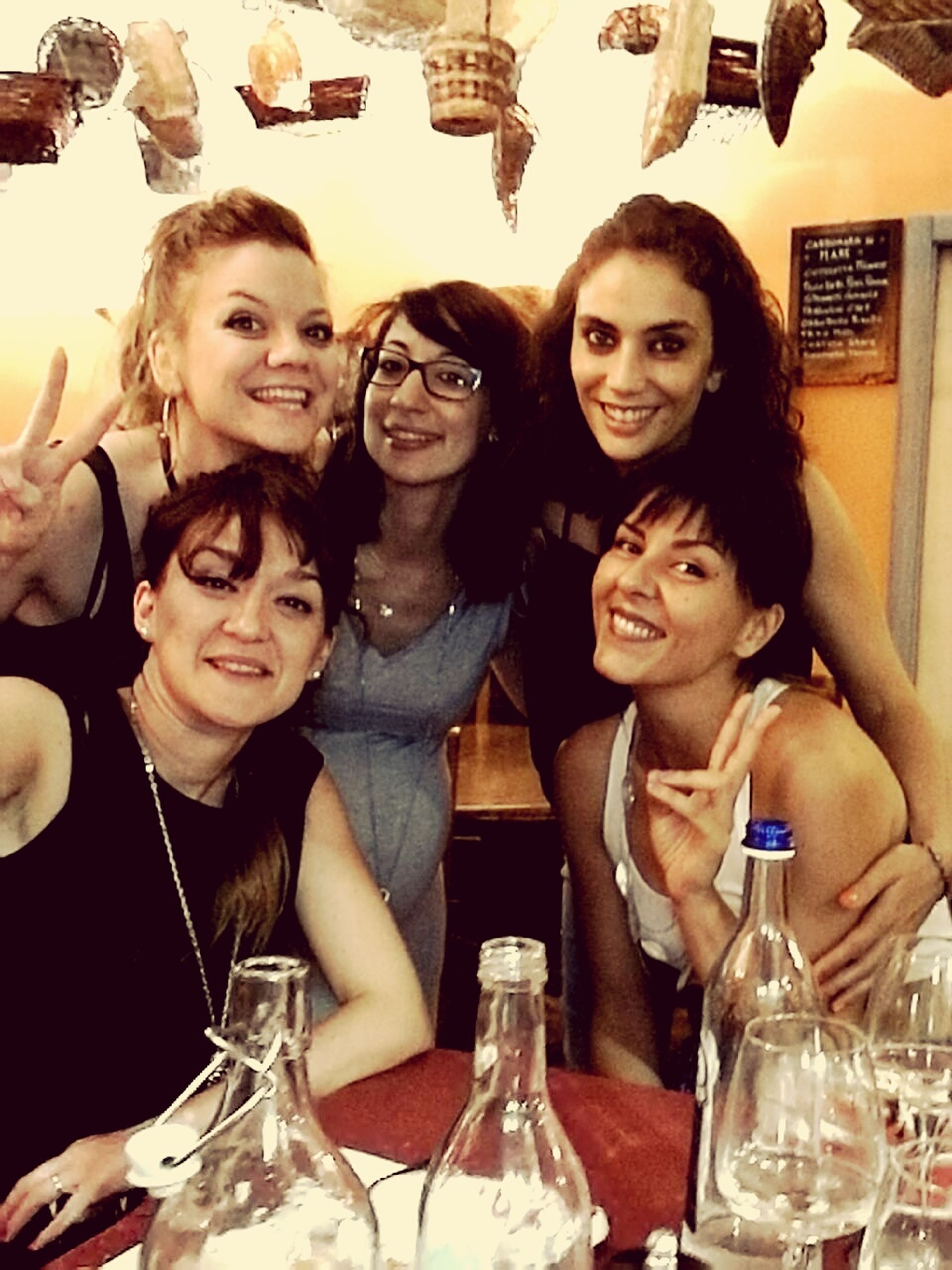 real people, togetherness, alcohol, smiling, young adult, happiness, friendship, young women, selfie, drink, portrait, wireless technology, indoors, day