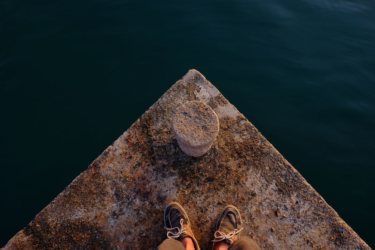 real people, water, one person, personal perspective, day, outdoors, standing, sea, human leg, low section, close-up, human body part, nature