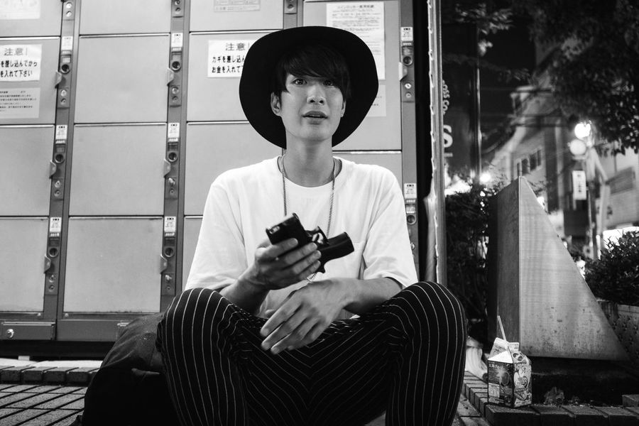 my phone is my weapon Hanging Out Monochrome Streetphoto_bw Street Portrait Black And White Portrait Smartphone