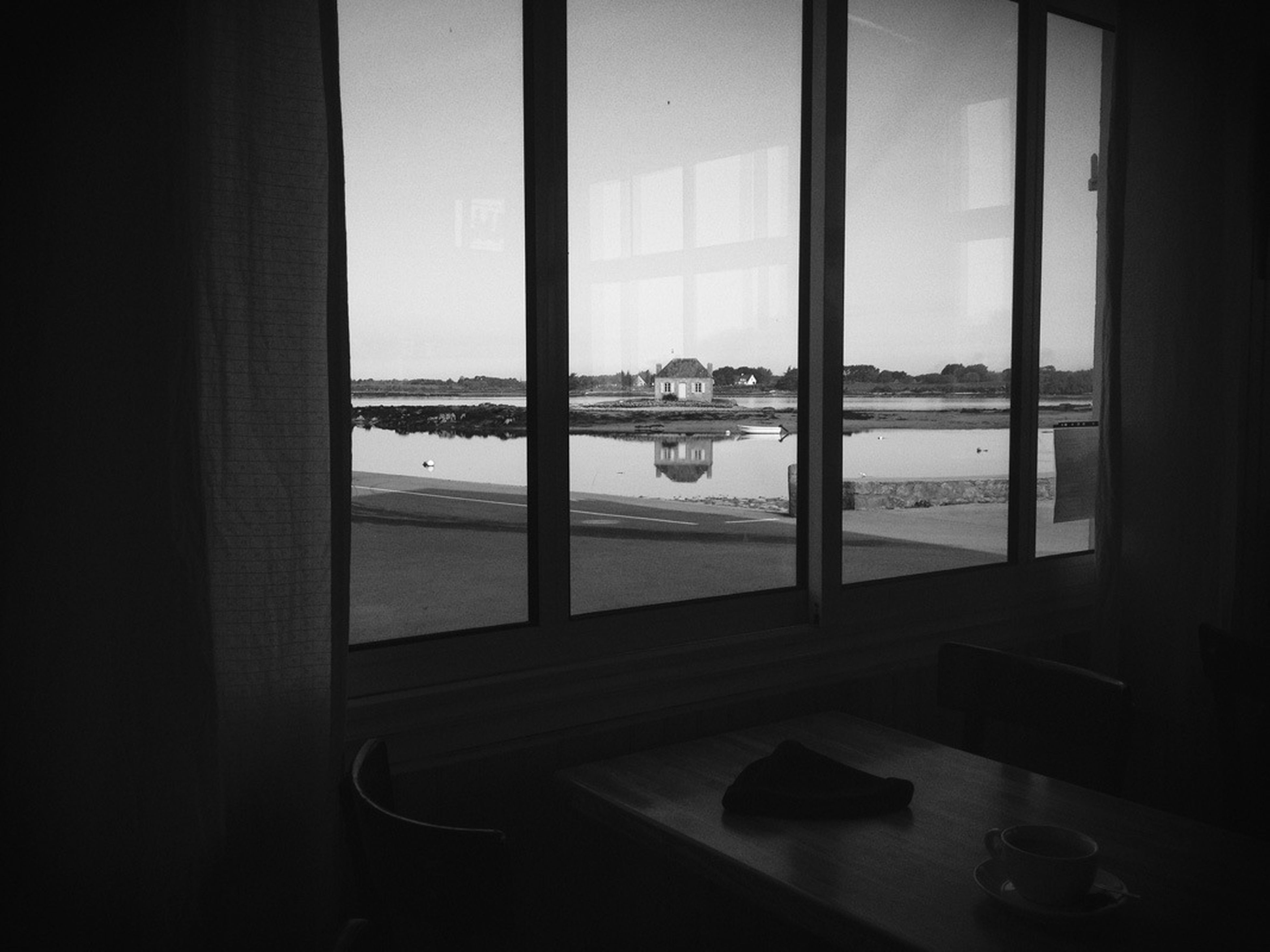 window, indoors, water, glass - material, transparent, sea, nautical vessel, mode of transport, transportation, boat, built structure, sky, architecture, looking through window, reflection, day, no people, travel, horizon over water, nature