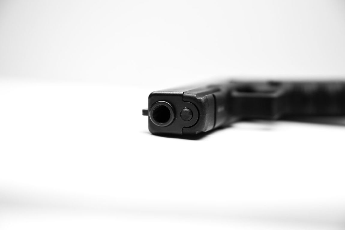 Isolated pistol with white background 2nd Amendment Death Gun Isolated Murder Politics Assault Weapon Close-up Dangerous Deadly Gun Control Gun Laws Guns Illegal Isolated Pistol Kill Killer No People Pistol Politics And Government Self Defense Shooting Target Practice War White Background