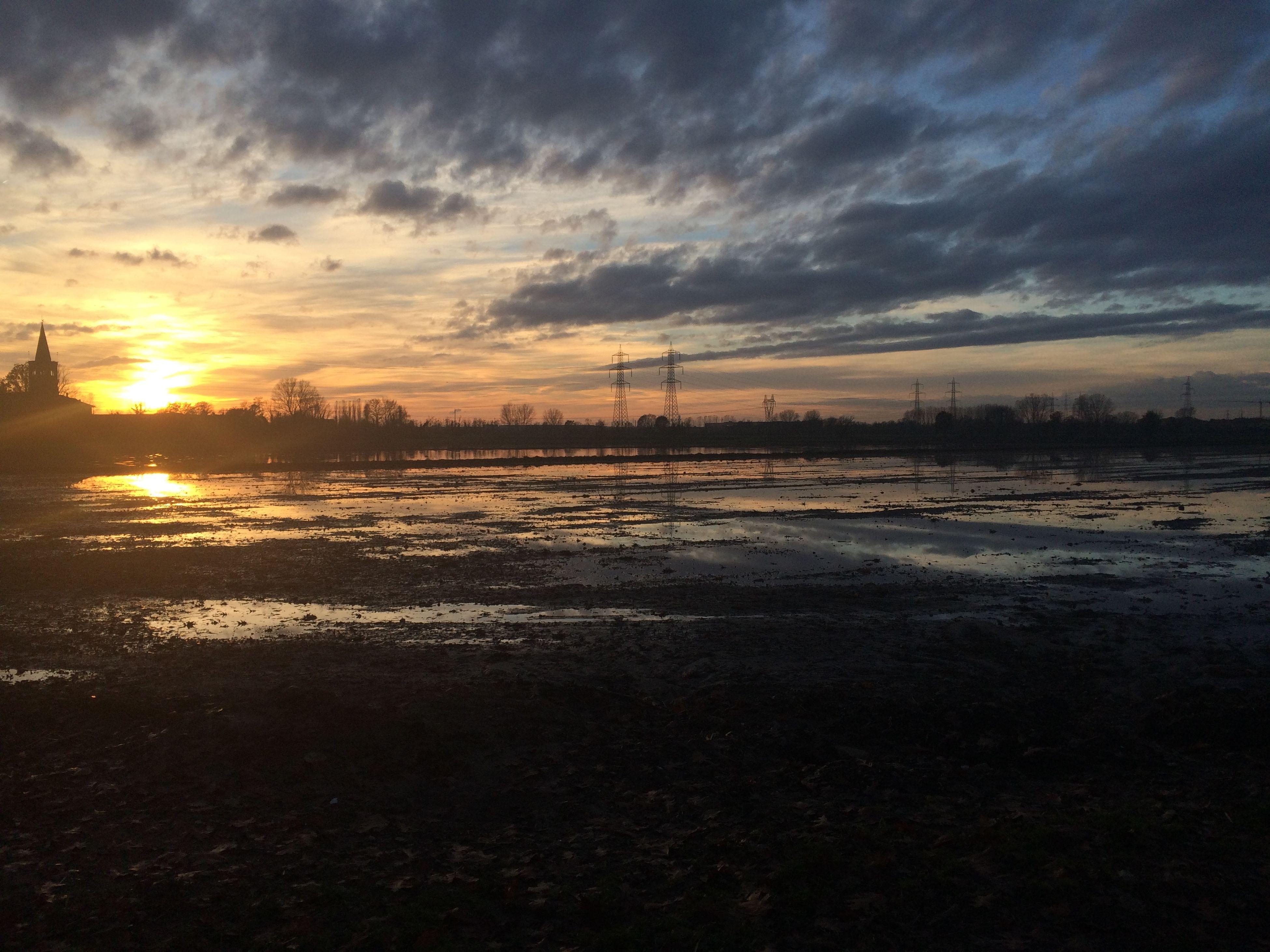 sunset, sky, cloud - sky, water, tranquil scene, scenics, tranquility, beauty in nature, sun, weather, nature, cold temperature, cloudy, silhouette, snow, orange color, sea, winter, idyllic, cloud