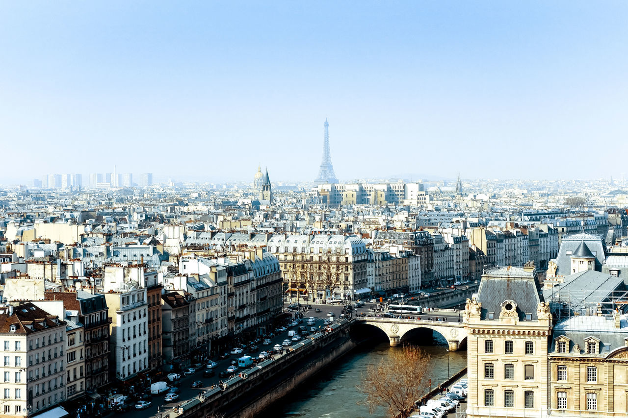 Architecture Building Exterior Built Structure Capital Cities  City City Life Cityscape Day Eiffel Tower Famous Place International Landmark Modern No People Outdoors Residential District River Sky Skyscraper Tall - High Tourism Tower Travel Destinations