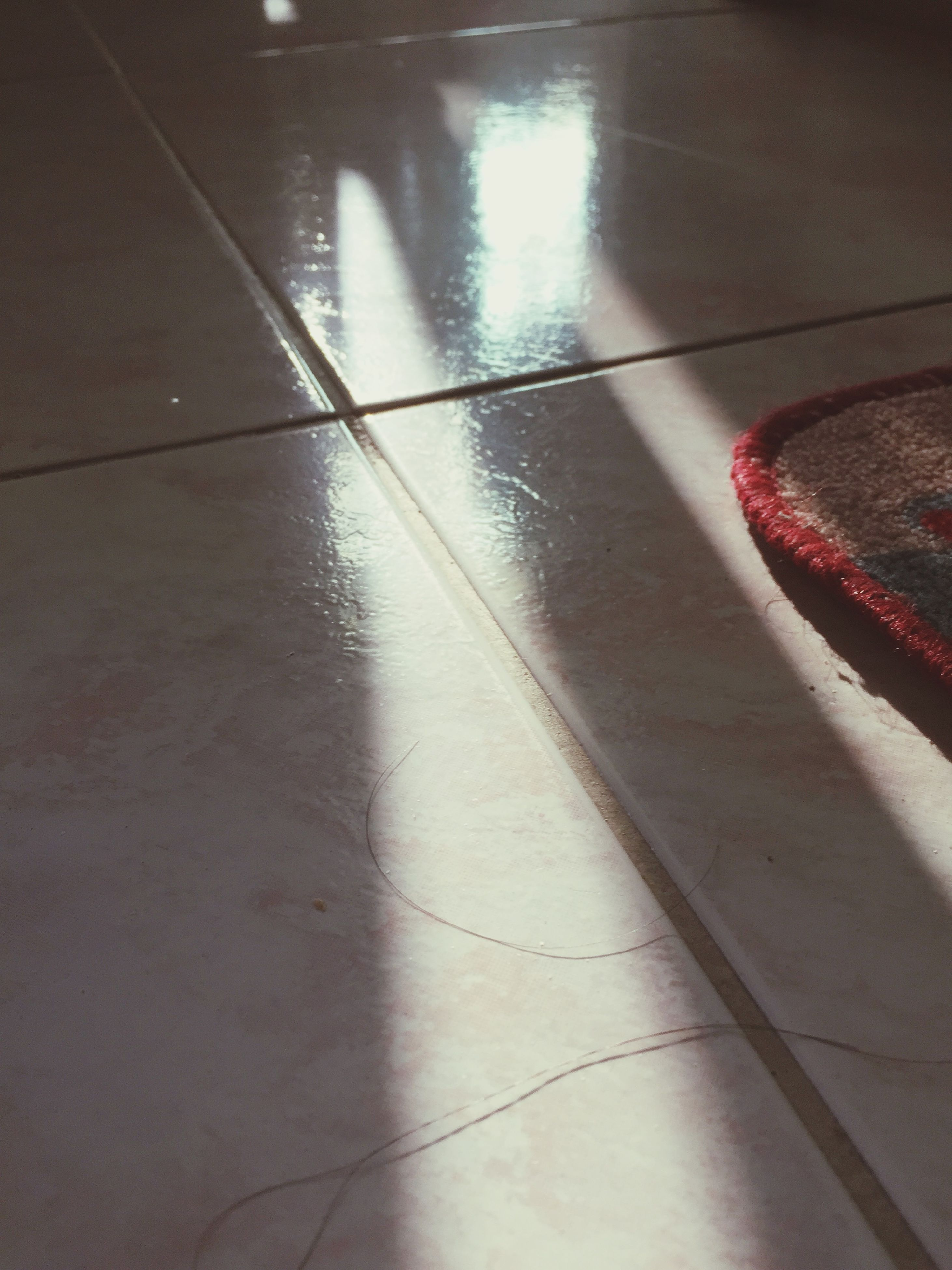 indoors, tiled floor, high angle view, flooring, illuminated, shadow, tile, red, wall - building feature, pattern, sunlight, no people, floor, reflection, empty, steps, built structure, architecture, absence, steps and staircases