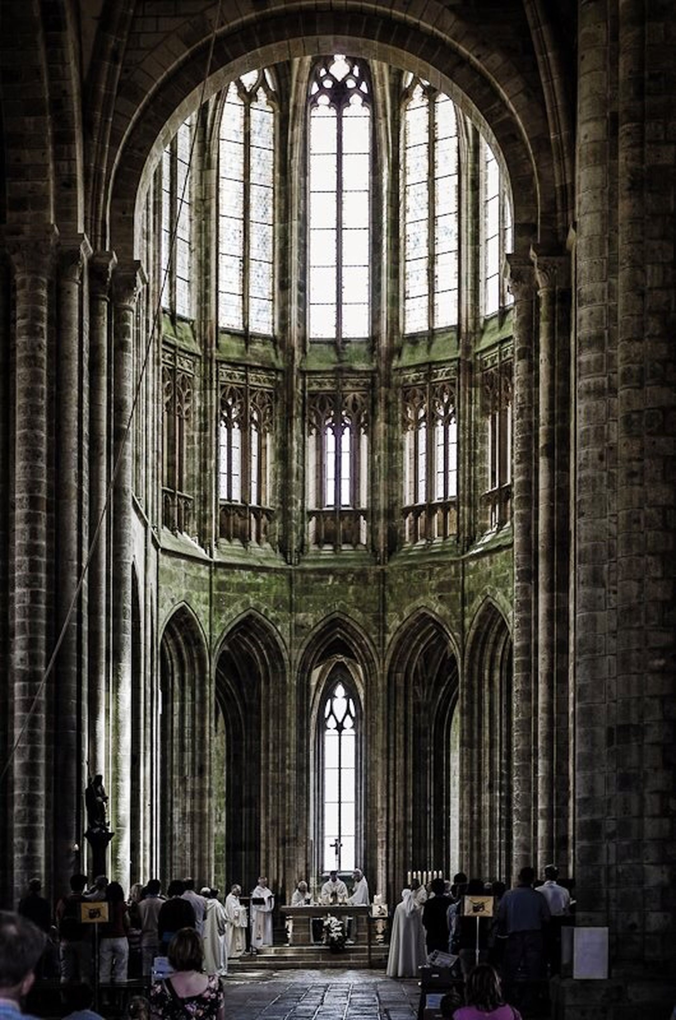 arch, indoors, architecture, built structure, church, place of worship, window, religion, spirituality, interior, men, archway, entrance, old, history, building exterior, day