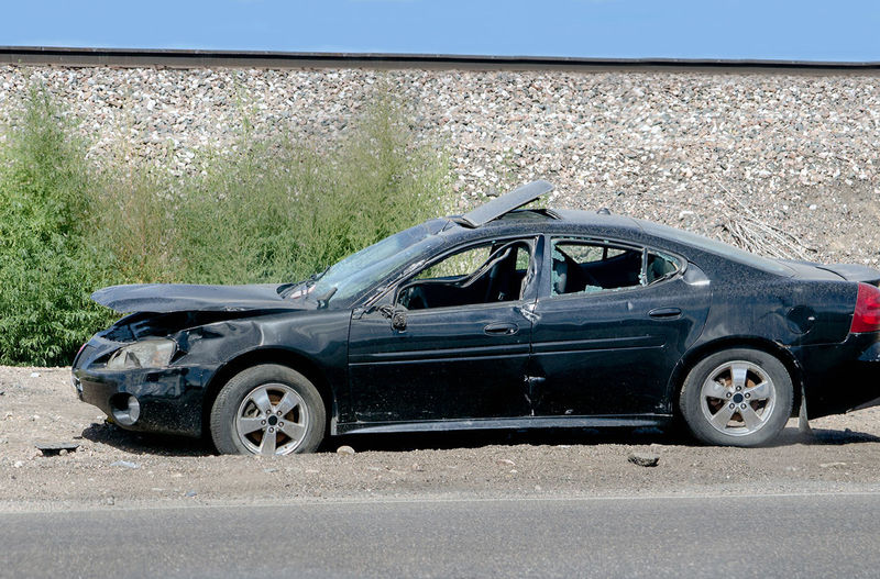 a damaged car is parked on the side of the road in Colorado USA. accident or foul play? Colorado Dark Foul Play Car Crash Damaged And Wrecked Day Destroyed Land Vehicle No People Outdoors Parked On Side Of Road Transportation Trashed Car Vehicle Interior