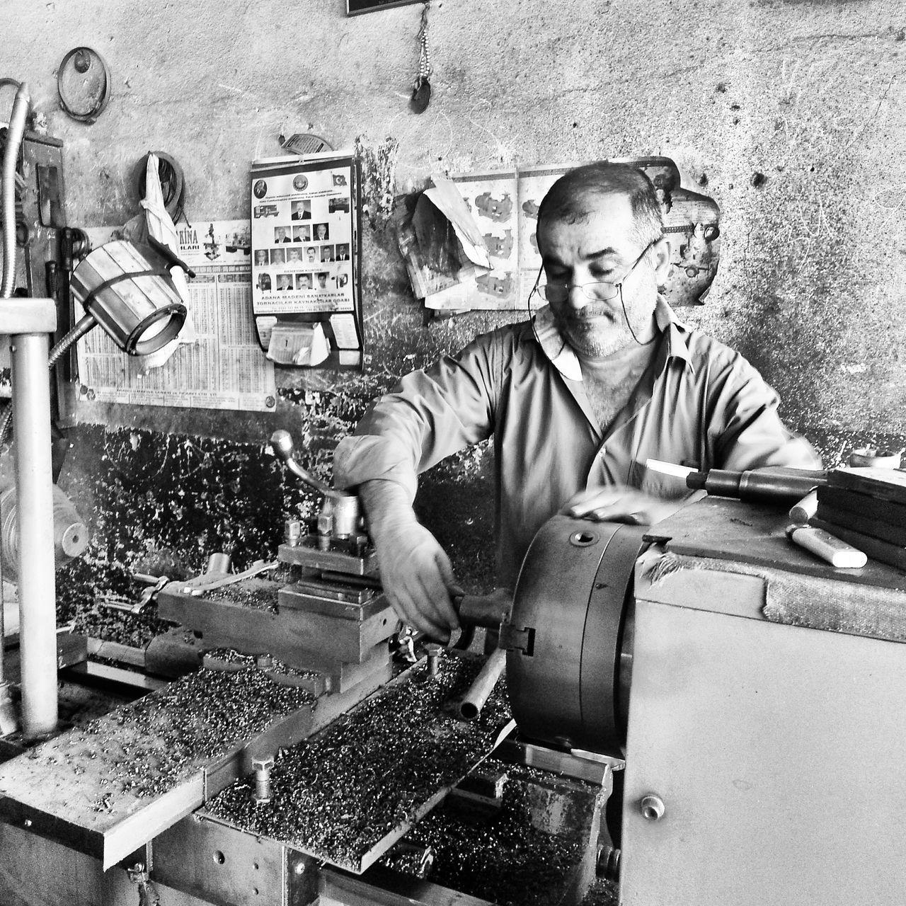 Man working on lathe