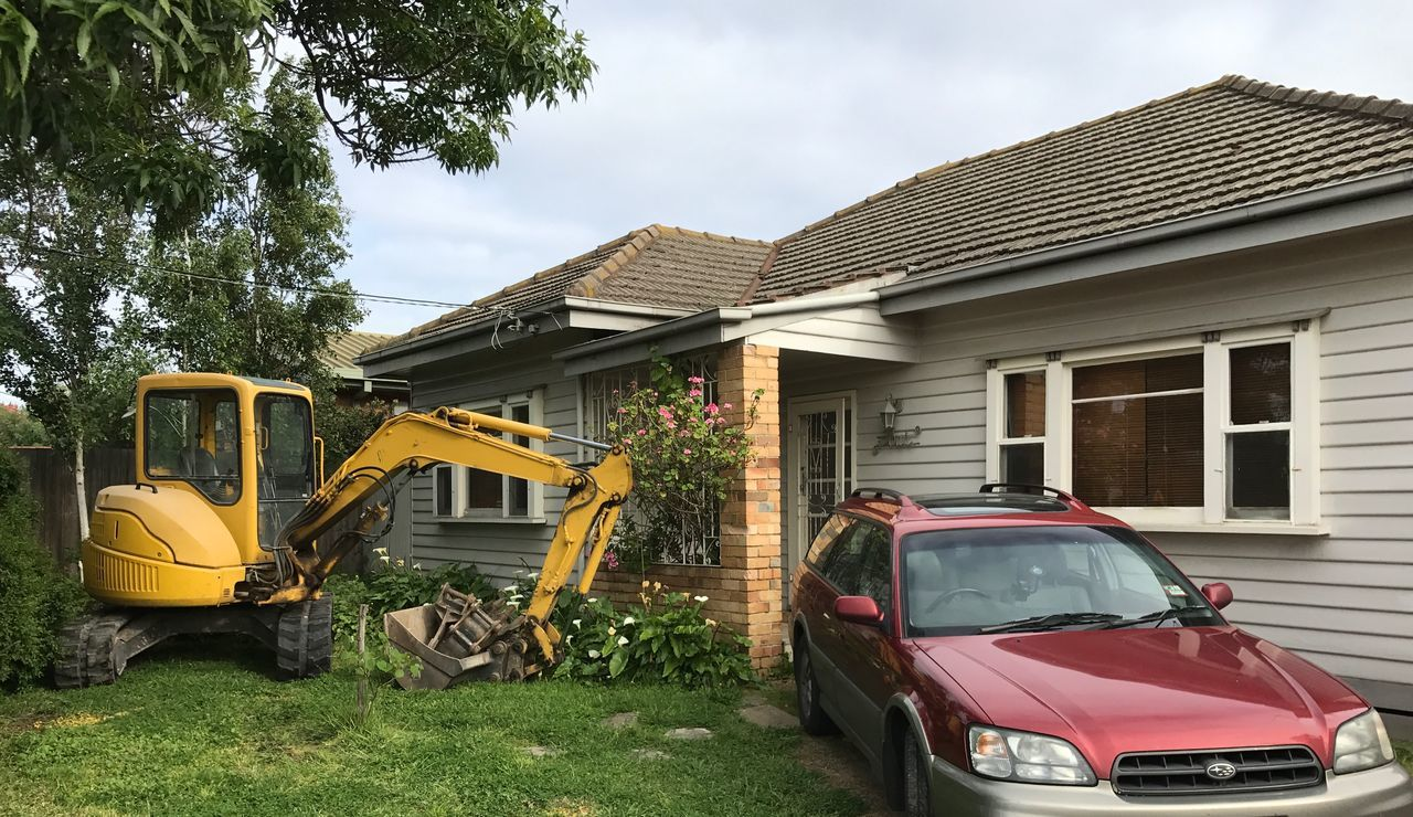 Architecture Automobile Building Exterior Built Structure Car Cars Cloud - Sky Day Driveway House Houses Moving House No People Outdoors Red Subaru Residential Building Sky Tree Yard Yellow Digger
