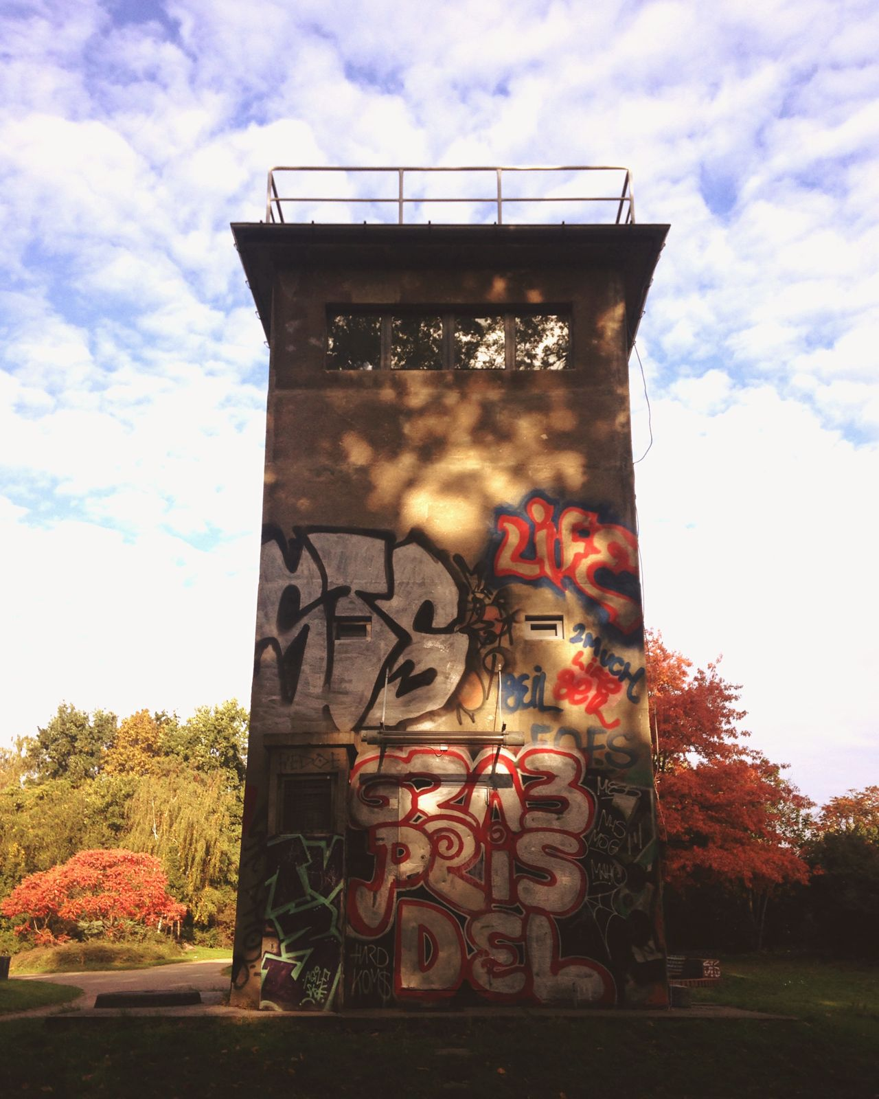 History in colour. At The Park Watchtower Historical Building Colors Autumn Trees Graffiti Early Morning Afterparty Hidden In Plain Sight