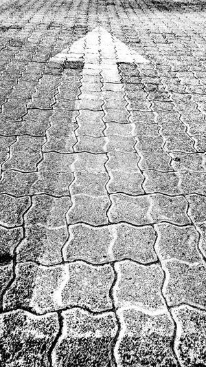 Onwards Backgrounds Full Frame Pattern Textured  Day No People Close-up Outdoors Direction Paving Arrow On Paving Show Direction