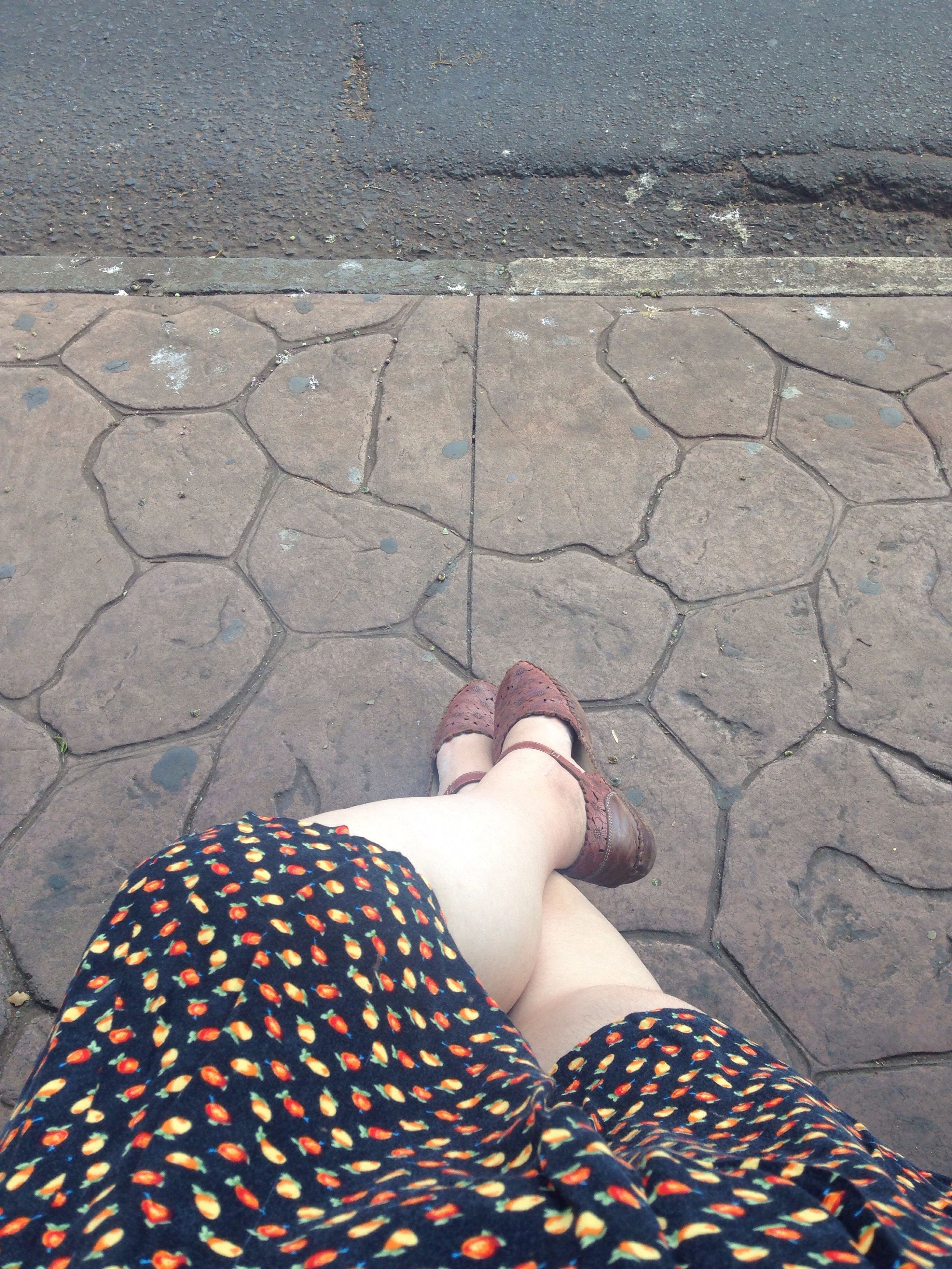 person, low section, standing, personal perspective, human limb, lifestyles, human foot, high angle view, leisure activity, relaxation, casual clothing, day, red, paving stone, limb, outdoors, footpath, one woman only