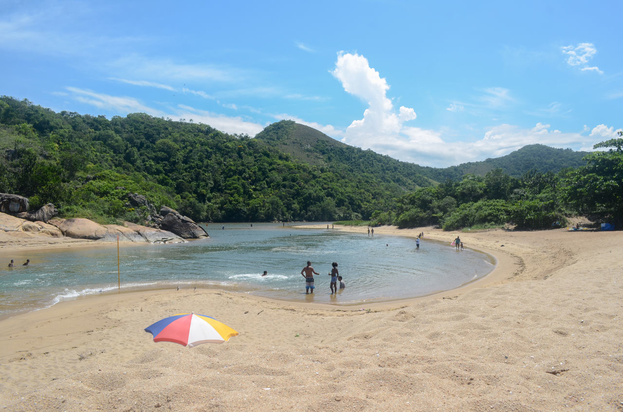 beach, sand, water, nature, sky, shore, beauty in nature, mountain, scenics, sea, tree, real people, day, outdoors, men, people