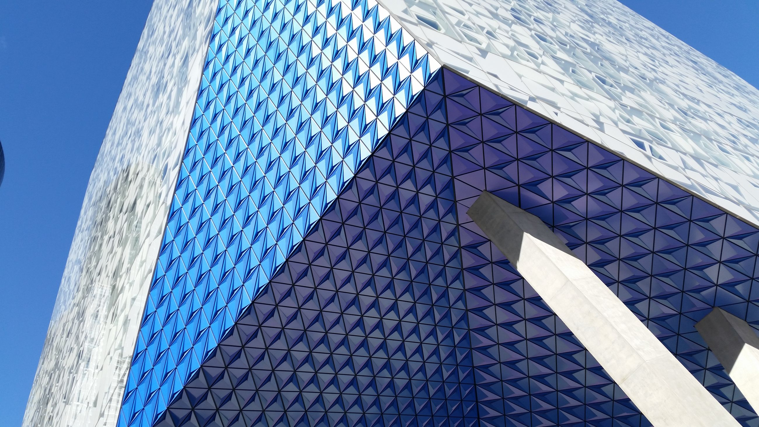blue, pattern, built structure, building exterior, architecture, repetition, sunlight, low angle view, modern, day, outdoors, clear sky, in a row, design, no people, city, office building, shape, white color, shadow