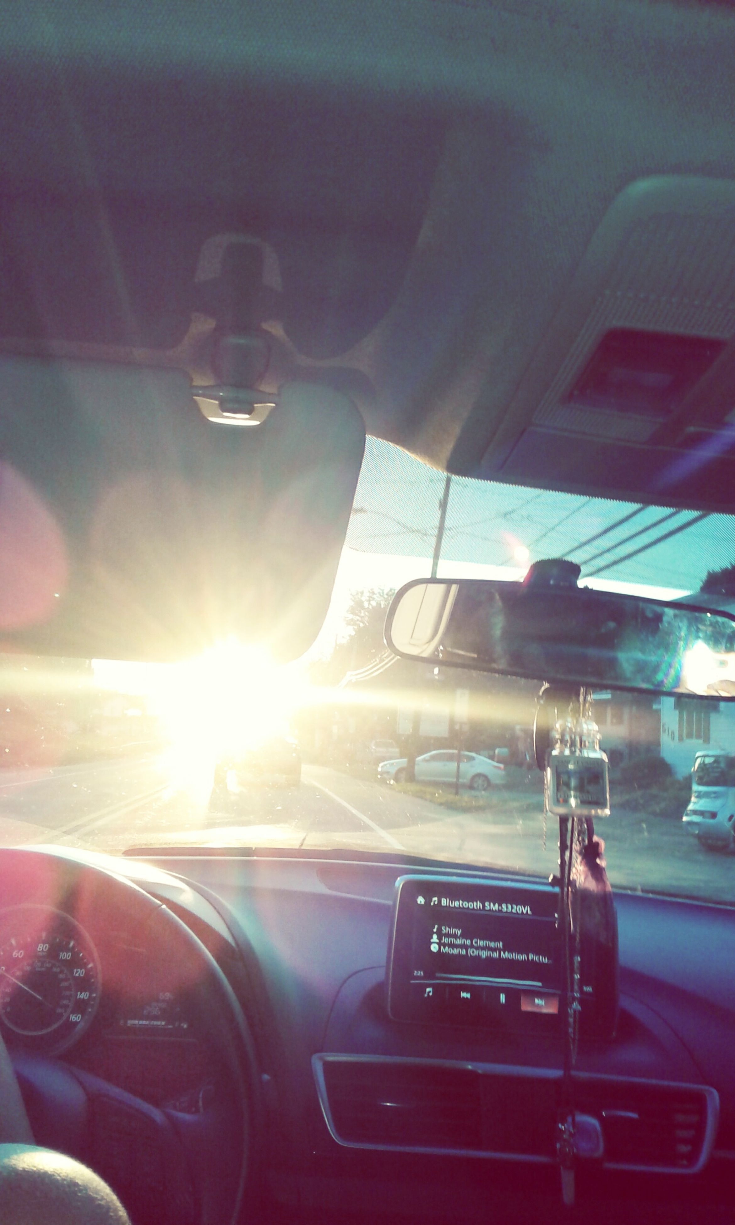 car, car interior, transportation, windshield, land vehicle, vehicle interior, steering wheel, mode of transport, dashboard, driving, windscreen, no people, close-up, day, speedometer, outdoors