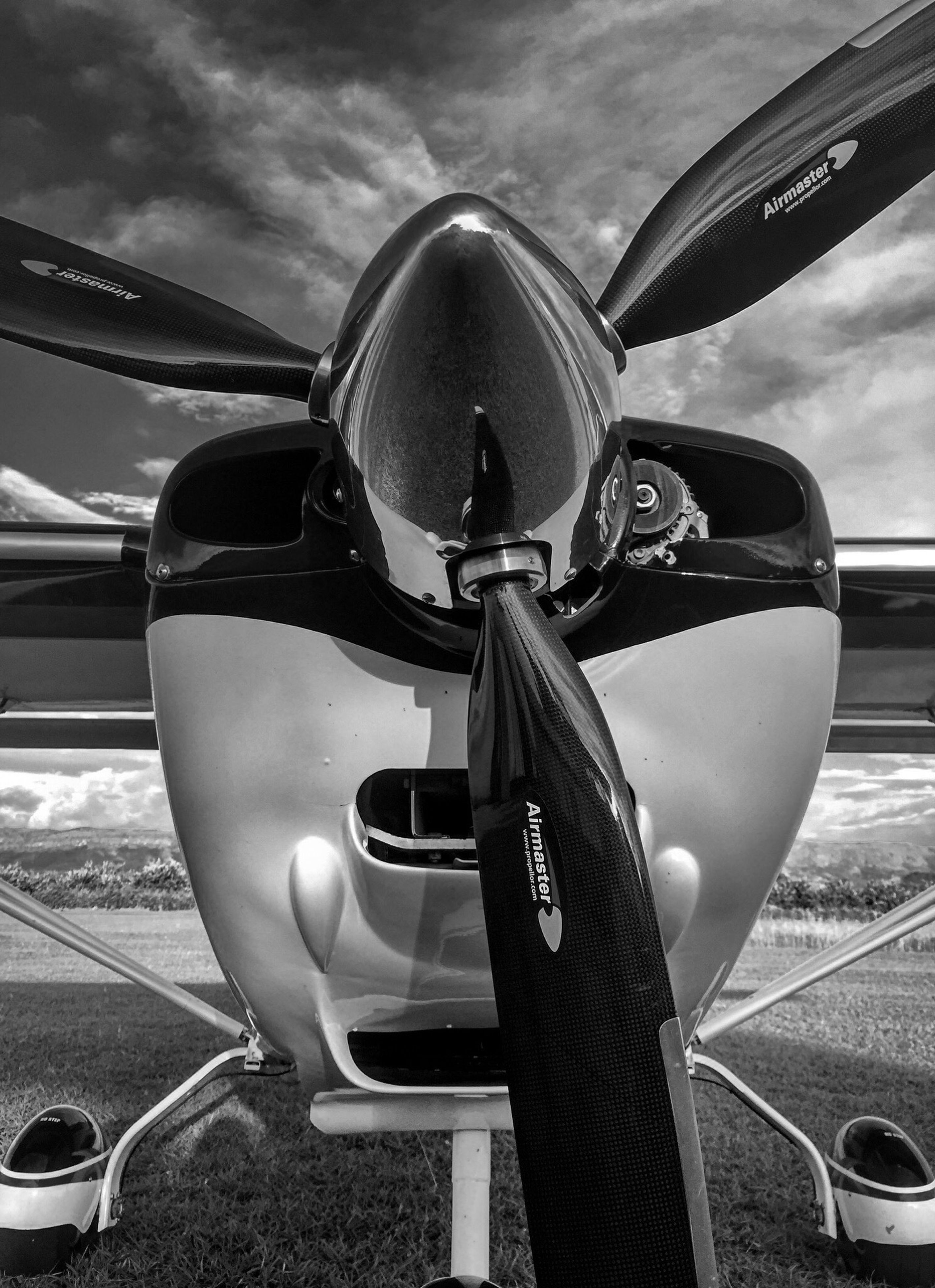 transportation, mode of transport, car, airplane, air vehicle, land vehicle, sky, travel, part of, cloud - sky, day, vehicle part, sunlight, stationary, outdoors, no people, vehicle interior, street, close-up, aircraft wing