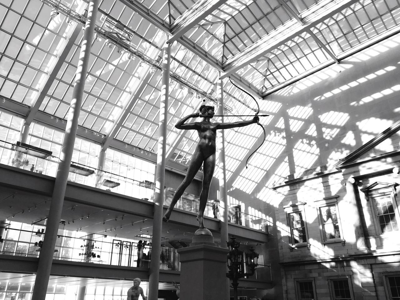 low angle view, ceiling, indoors, working, real people, day, skill, occupation, men, statue, sculpture, manual worker, architecture, one person, window washer, people