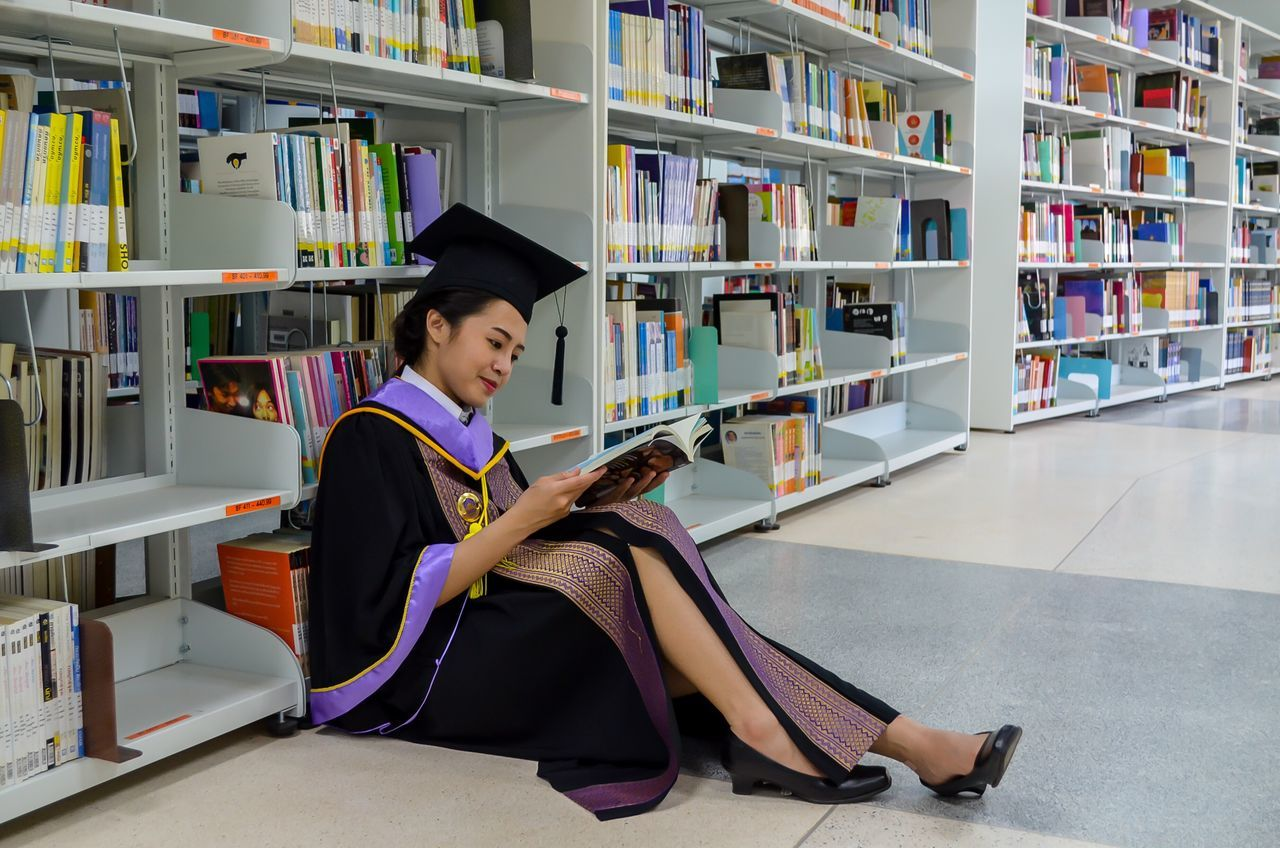Book Bookshelf Library Reading Full Length Sitting Side View Education Child Learning One Person Children Only Indoors  Student People Shelf Spelling Childhood Young Adult Adult