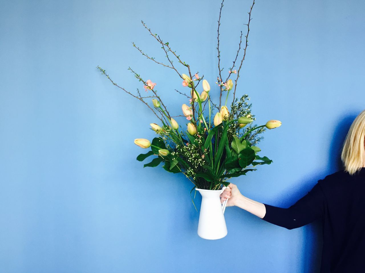 Adult Adults Only Beauty In Nature Blue Bouquet Close-up Copy Space Day Flower Flower Arrangement Freshness Freshness Growth Holding Human Body Part Human Hand Nature One Person People Plant Real People Sky Spring Tulip Women