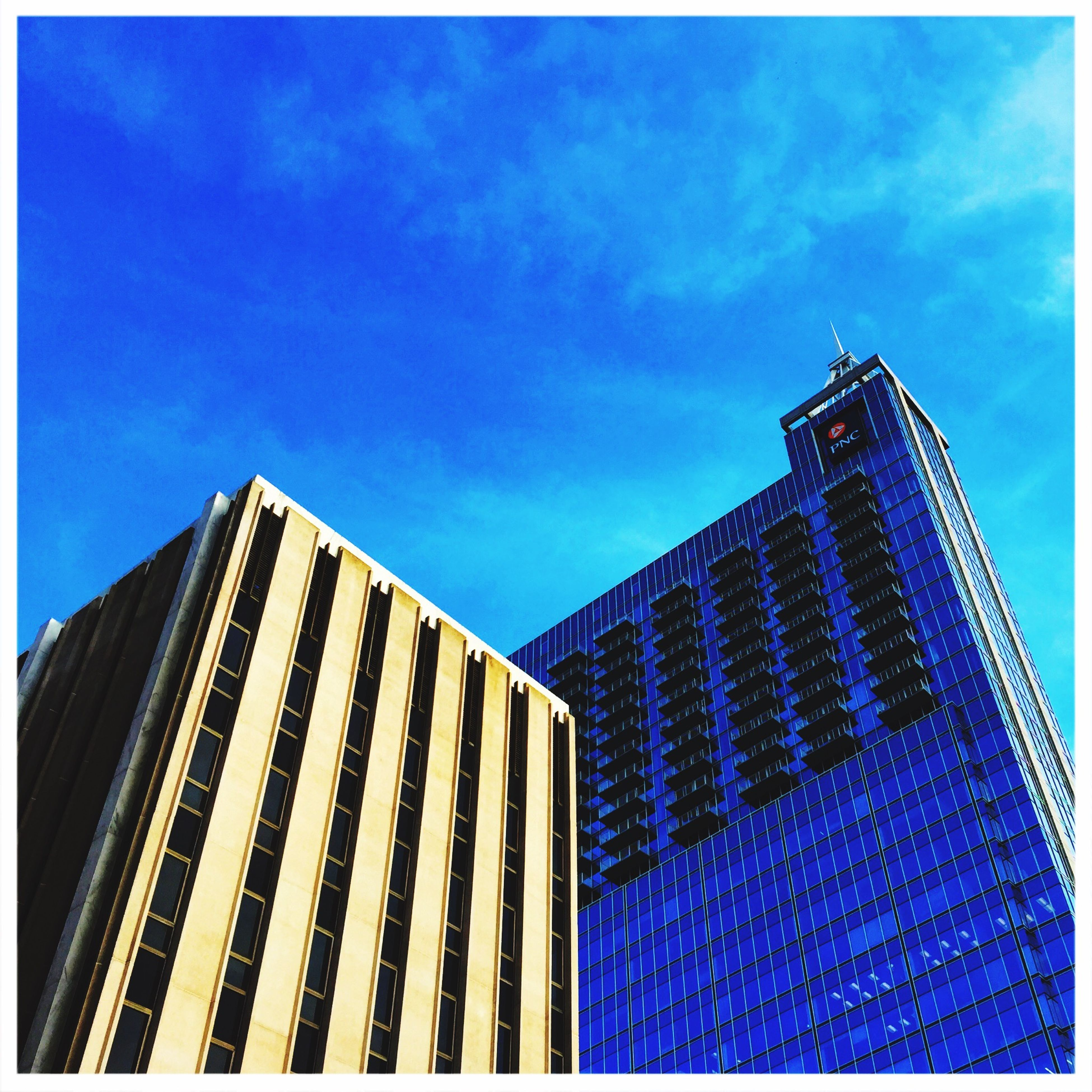 architecture, building exterior, built structure, low angle view, modern, sky, skyscraper, office building, city, tower, blue, transfer print, tall - high, auto post production filter, cloud - sky, glass - material, building, cloud, reflection, day