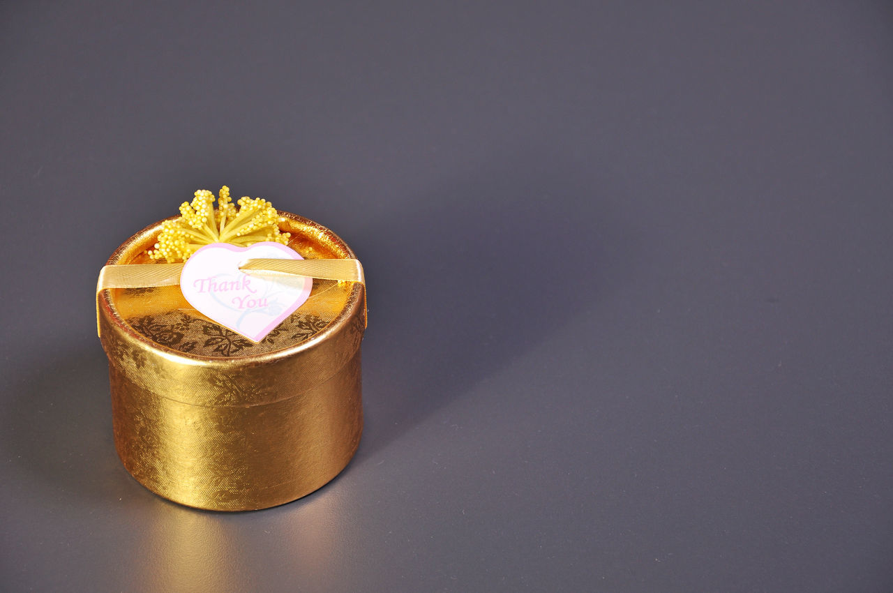 Golden Gift Box On Gray Background