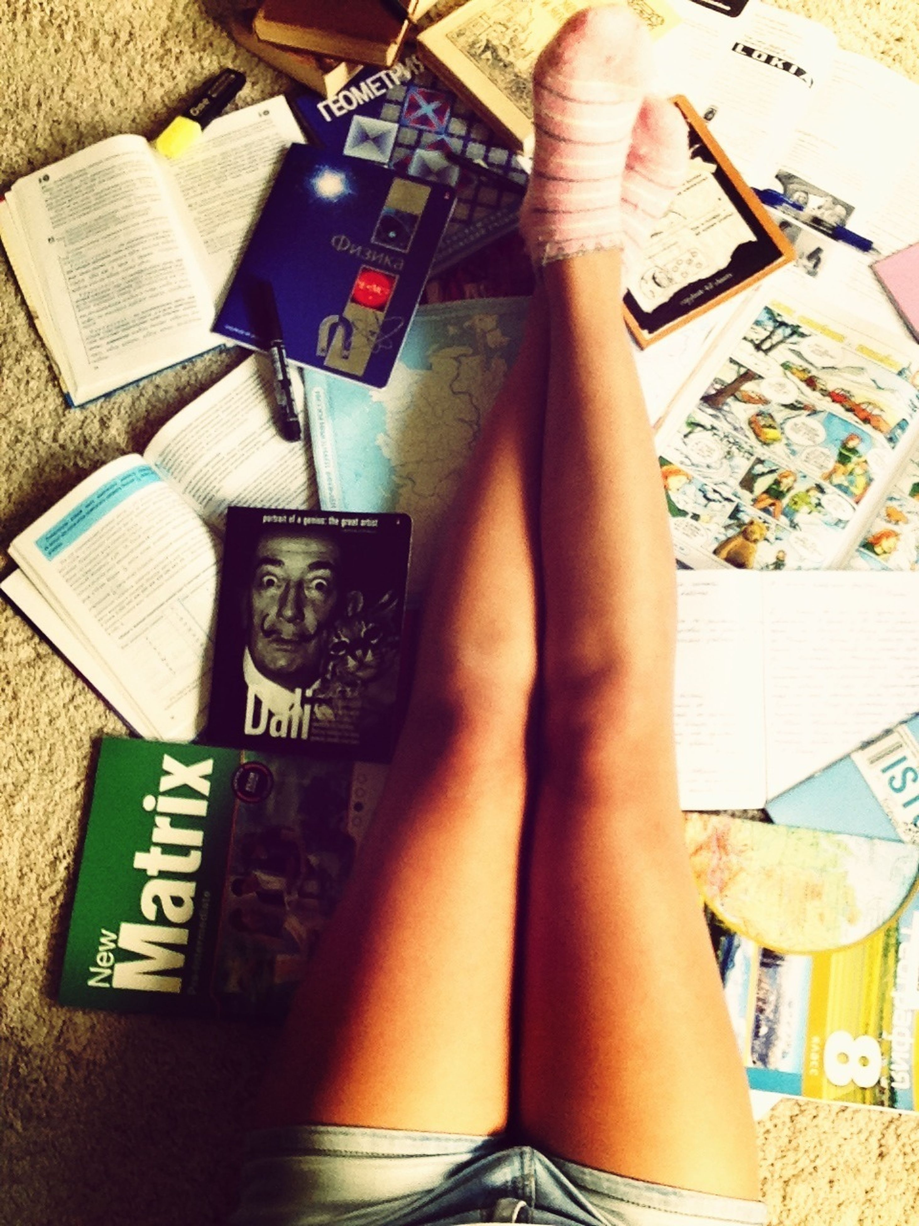 indoors, lifestyles, person, book, leisure activity, low section, part of, relaxation, high angle view, barefoot, home interior, wireless technology, communication, personal perspective, legs crossed at ankle
