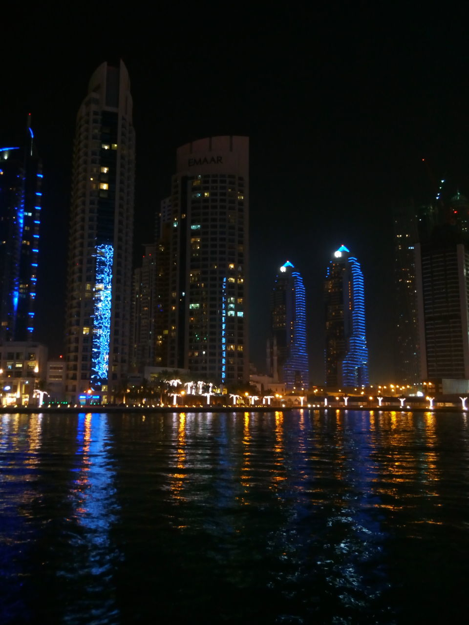 illuminated, night, architecture, built structure, building exterior, water, waterfront, reflection, travel destinations, tourism, city, no people, skyscraper, outdoors, sky, cityscape