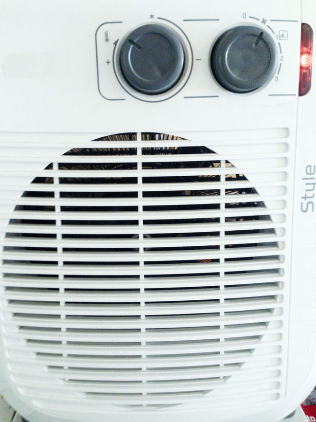 Keeping Cool with an Electric Fan Air Conditioning Apparatus Appliance Blowing Close-up Cooling  Day Electric Fan Heat Hot Indoors  Machine Modern No People Part Of Round Ventilation White