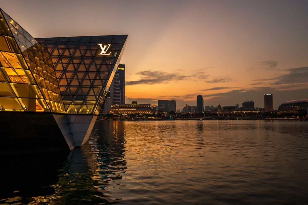 Golden sunset in the Lion City Architecture Building Exterior Built Structure City Sunset Sky Travel Destinations Water Skyscraper River Urban Skyline No People Cityscape Outdoors Day Marinabay EyeEmNewHere