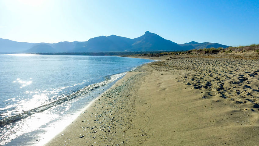Krull&Krull Images Mallorca Beach Beauty In Nature Clear Sky Day Landscape Mountain Mountain Range Nature No People Outdoors Sand Scenics Sea Sky Son Serra De Marina Sunlight Tranquil Scene Tranquility Water