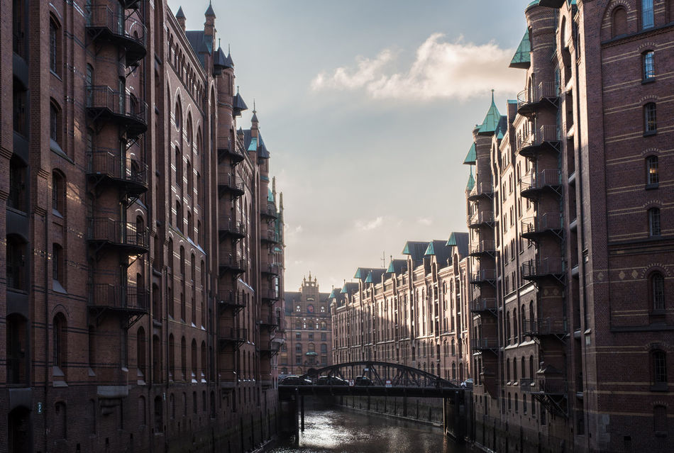 Architecture Architecture Brick Bridge Building Exterior Built Structure Channel City Cloud - Sky Day Fleet Germany Hamburg Historic No People Outdoors River Sky Skyscraper Speicherstadt Sunlight Travel Destinations Warehouse District Water World Heritage