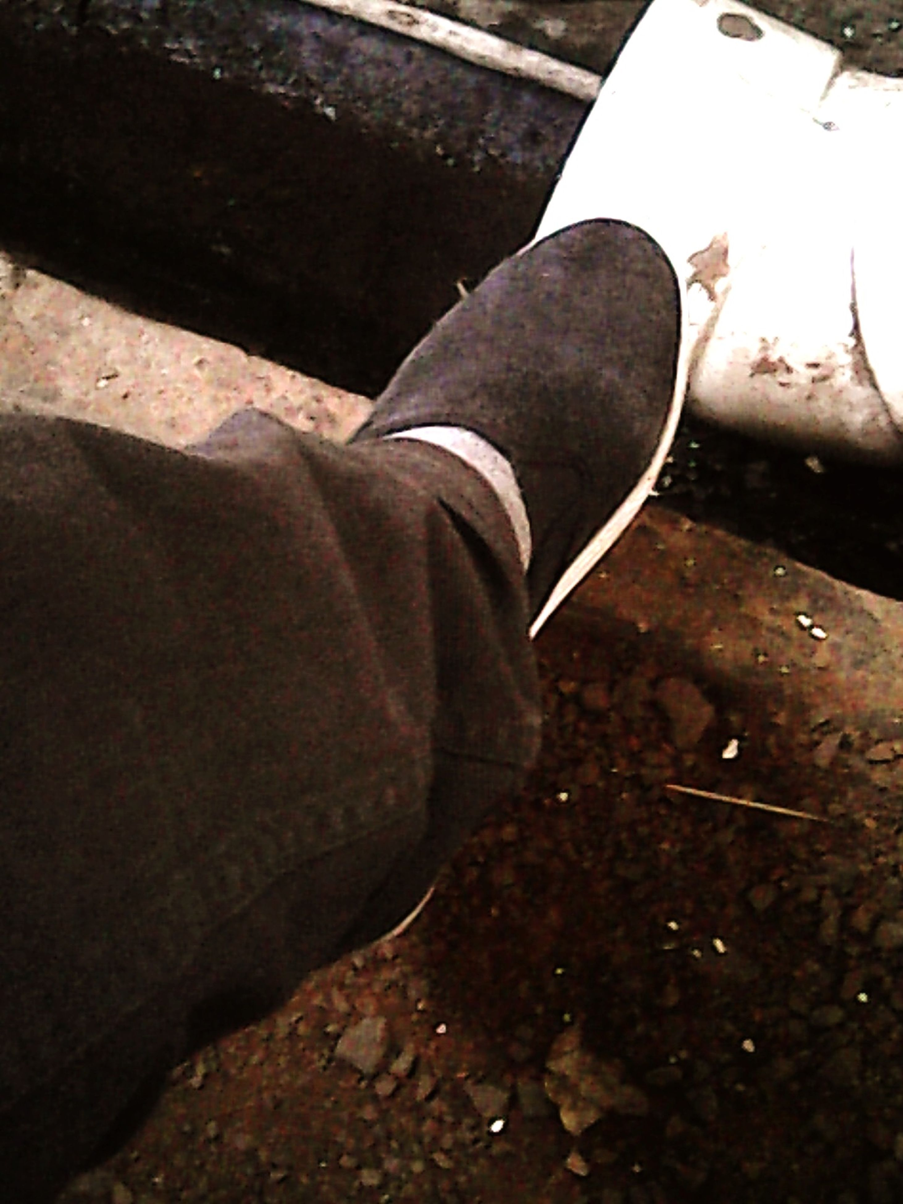 shoe, low section, person, jeans, high angle view, footwear, personal perspective, lifestyles, part of, standing, close-up, street, men, casual clothing, human foot, day, sitting