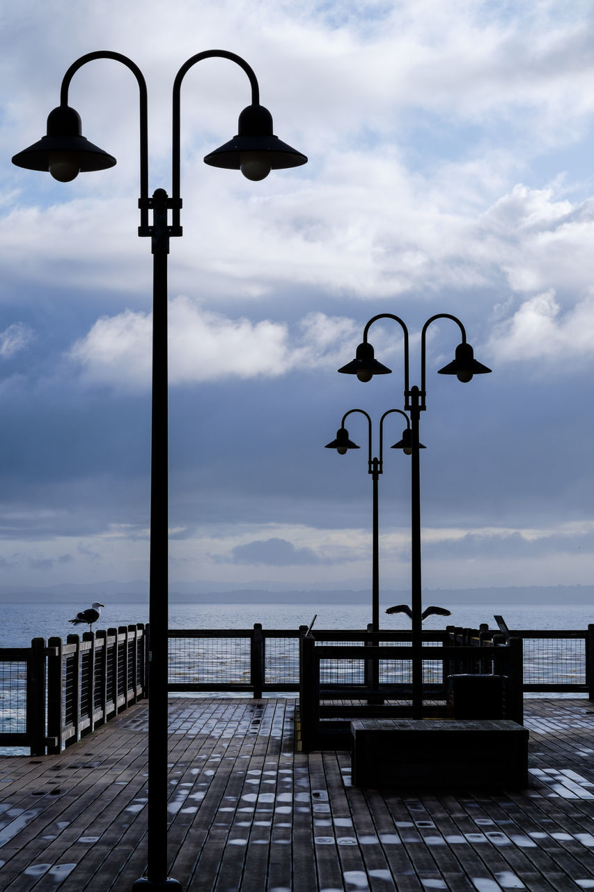 street light, cloud - sky, sky, lighting equipment, sea, outdoors, day, nature, no people, water, beauty in nature, horizon over water