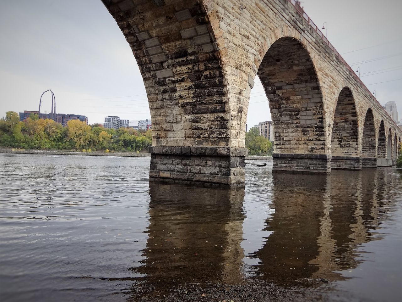 St. Anthony Main trails in Minneapolis MN Arch Architecture Bridge Bridge - Man Made Structure Built Structure Connection Day Nature No People Outdoors Reflection River Sky Stone Tabphotography Travel Destinations Tree Water Water Reflections Waterfront