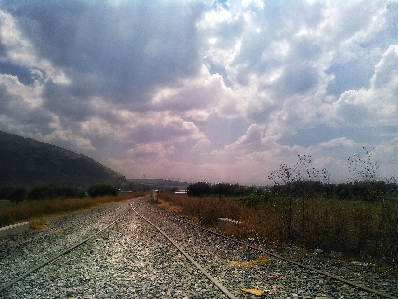 Pulled apart | Apartado | Paragraphe | Absatz. Sky Cloud - Sky Nature No People Beauty In Nature Agriculture Outdoors Water Scenics Tree Day Road Train Exploring First Eyeem Photo Mexico Old Landscapes Agriculture Cityscape Paths Train Tracks Beautiful Nature Tree