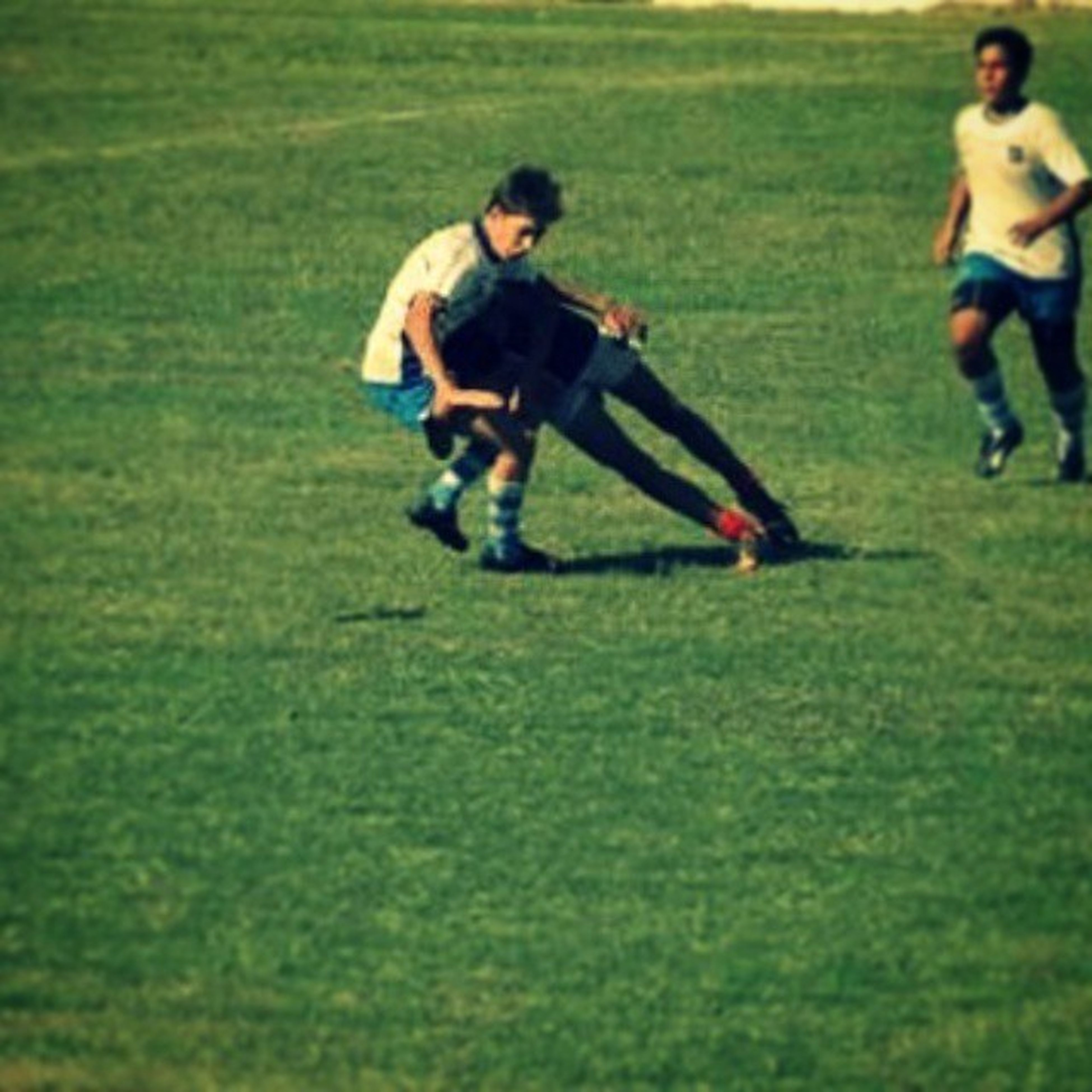 grass, lifestyles, leisure activity, person, full length, running, casual clothing, young men, field, fun, playing, playful, sport, happiness, grassy, boys, enjoyment, elementary age