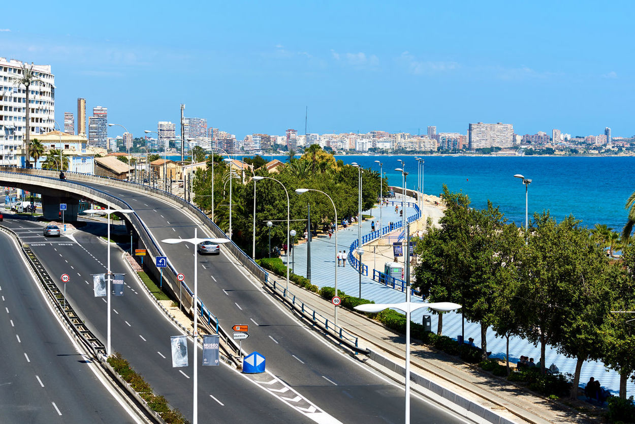 Alicante, Spain - April 17, 2017: Postiguet Beach and the highway of Alicante city. Alicante is a main resort city on the Costa Blanca. Spain Alicante Alicante, Spain City Cityscape Coastline Costa Blanca Mediterranean Sea Postiguet Beach Promenade Road SPAIN Beach Beauty In Nature Highway Landscape Outdoors Roadway Sea Seafront Street Sunny Day Tourist Resort Travel Destinations Urban Waterfront