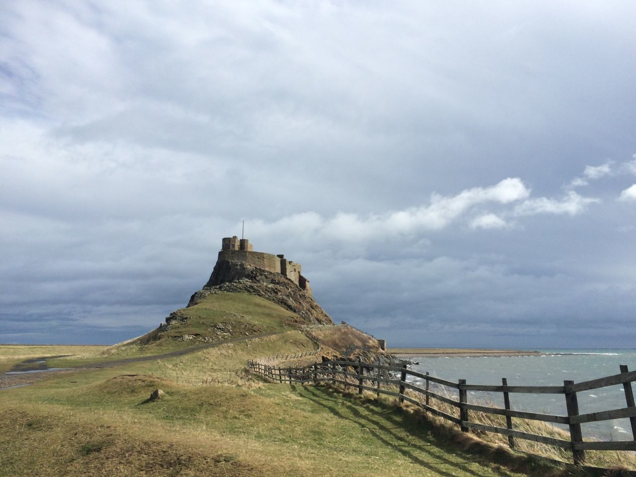 Holy Island Castle Ruin Ruins Fence Cloud Rugged Nature Natural Beauty Coast Sea Original No Filter Northumberland Fine Art Photography On The Way Lindisfarne Adventure Club Showcase July Hidden Gems  Pivotal Ideas