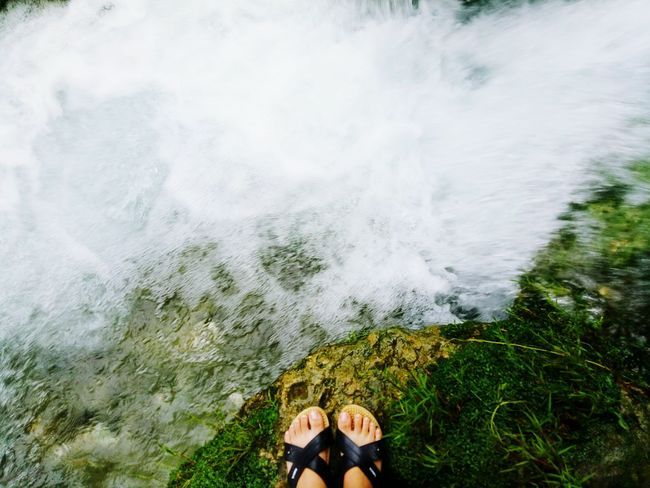 Low Section Real People Human Leg Lifestyles One Person Outdoors Day Standing Leisure Activity Water Nature Human Body Part Beauty In Nature People Adults Only Adult Waterfall Motion Green Color Waterfalls Of Time Waterfalls In Philippines Waterfalls And Mountains Freshness Power In Nature Adventure