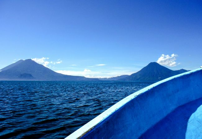 Lago de Atitlán Blue Water Beauty In Nature Mountain Range Sky Tranquil Scene No People Volcanoes Volcano Peak Mountains And Water Mountains In Background Volcanoes And Water On A Boat Mountainscape Blue Color Blue Water Lago Atitlán Lago De Atitlan Lake Lake View Guatemala Lake Atitlán Lake Atitlan Guatemala Lake Attitlan, Guatamala Travel Photography