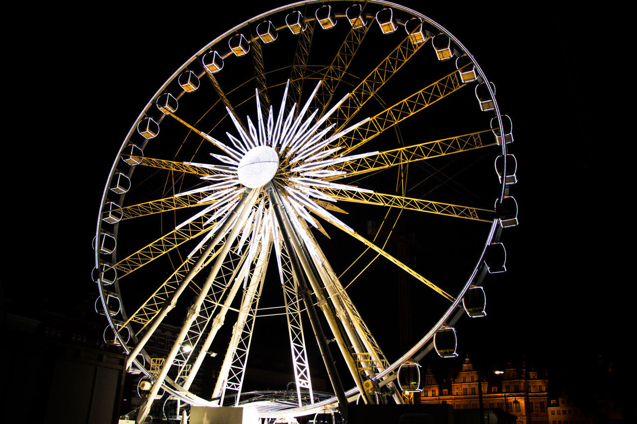 amusement park, arts culture and entertainment, ferris wheel, night, illuminated, amusement park ride, low angle view, big wheel, no people, outdoors, black background, sky