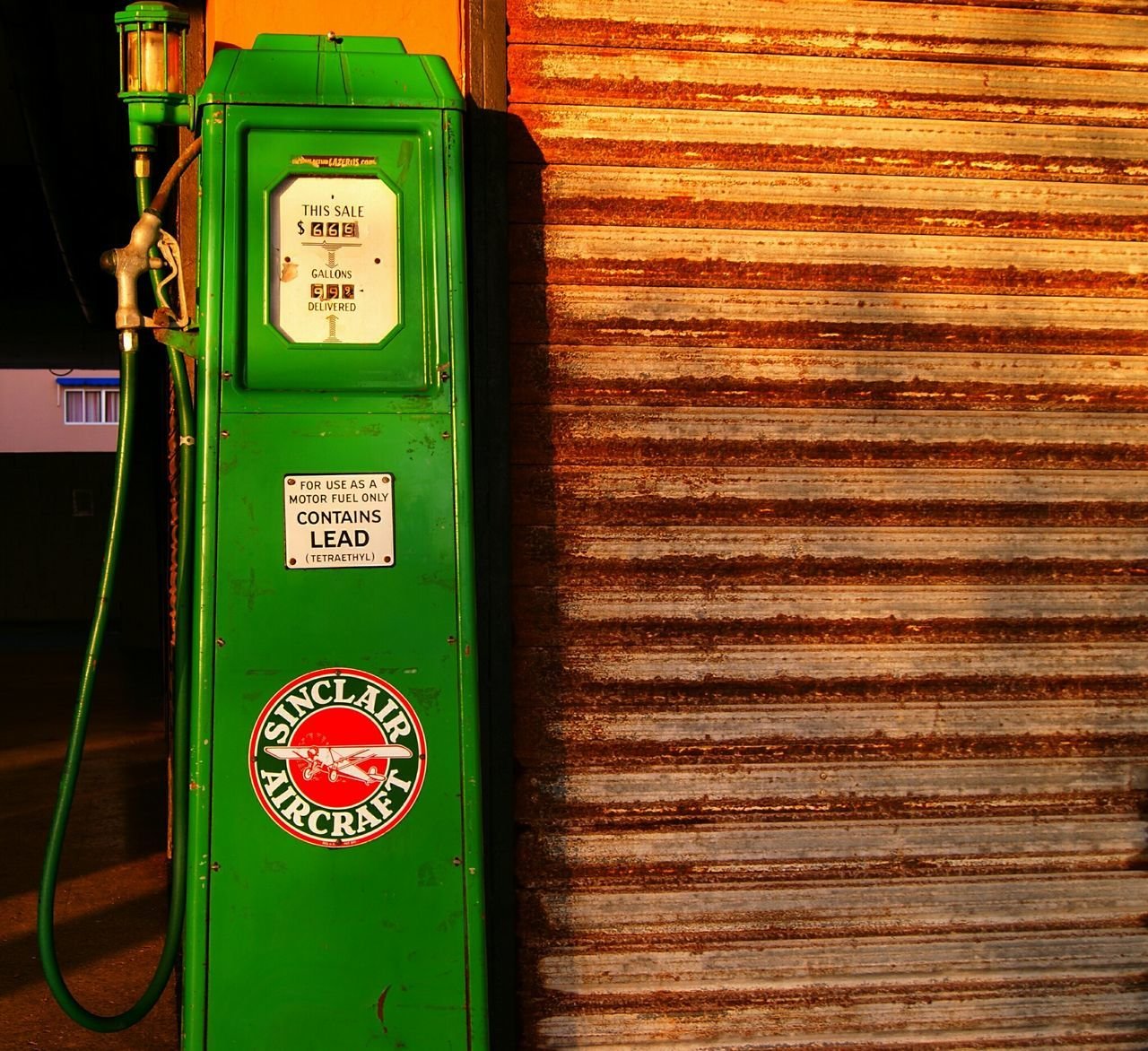 text, instrument of measurement, communication, fuel pump, gasoline, no people, outdoors, old-fashioned, day, fuel and power generation, gauge, close-up, pay phone